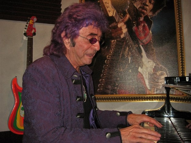 Jim Peterik plays grand piano